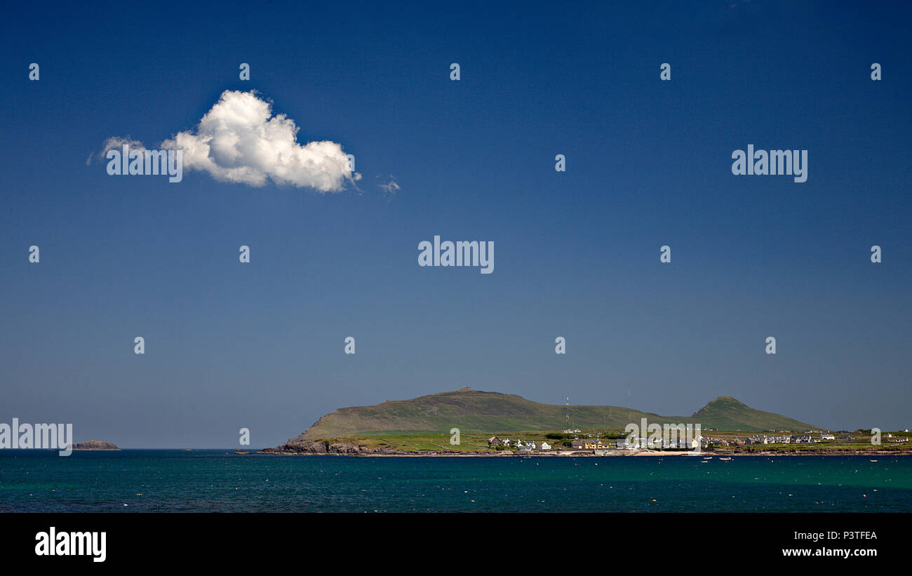 Cumulus cloud over mountains and sea on the west coast of Ireland at Dingle - Stock Image