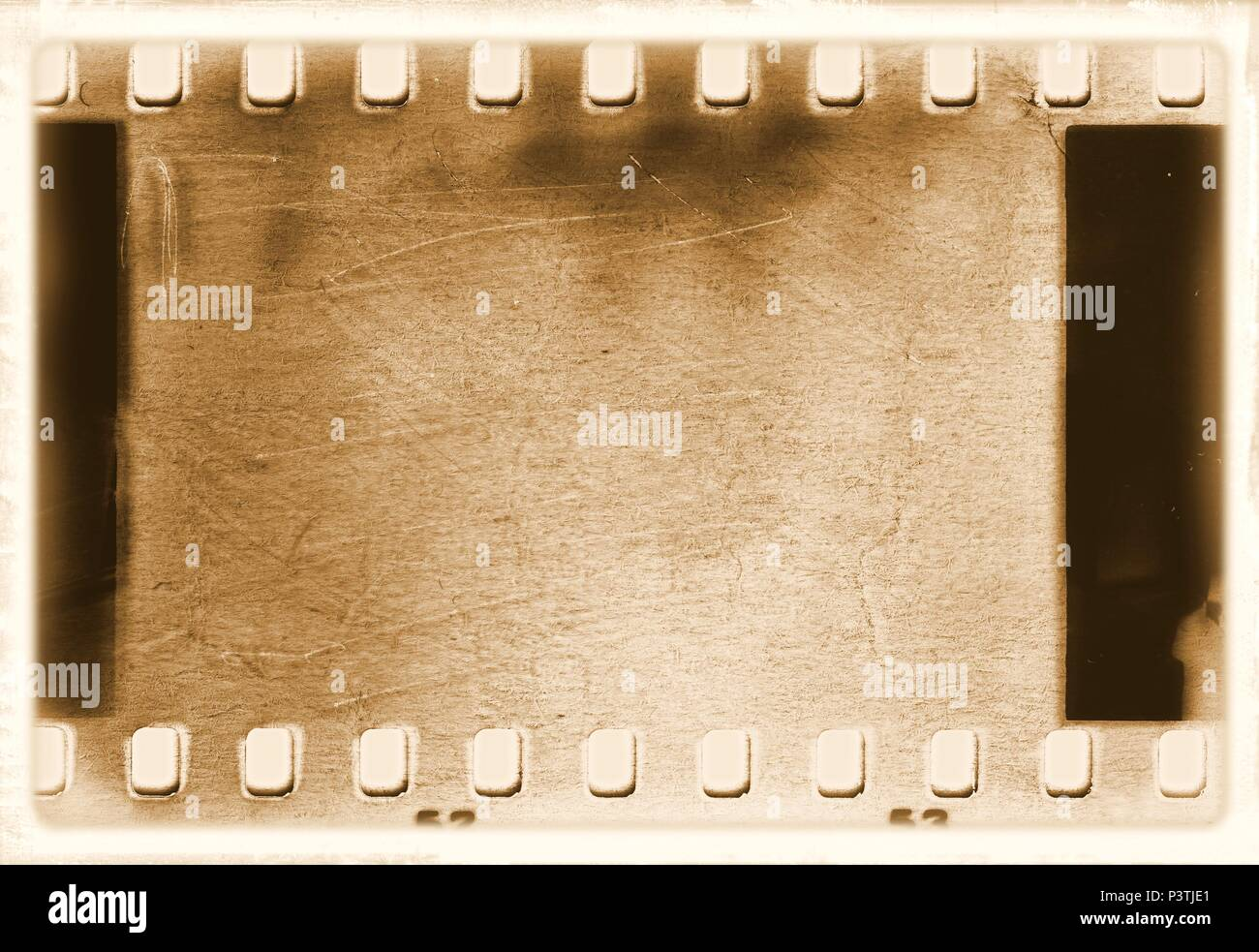 Vintage film strip frame in sepia tones. Stock Photo