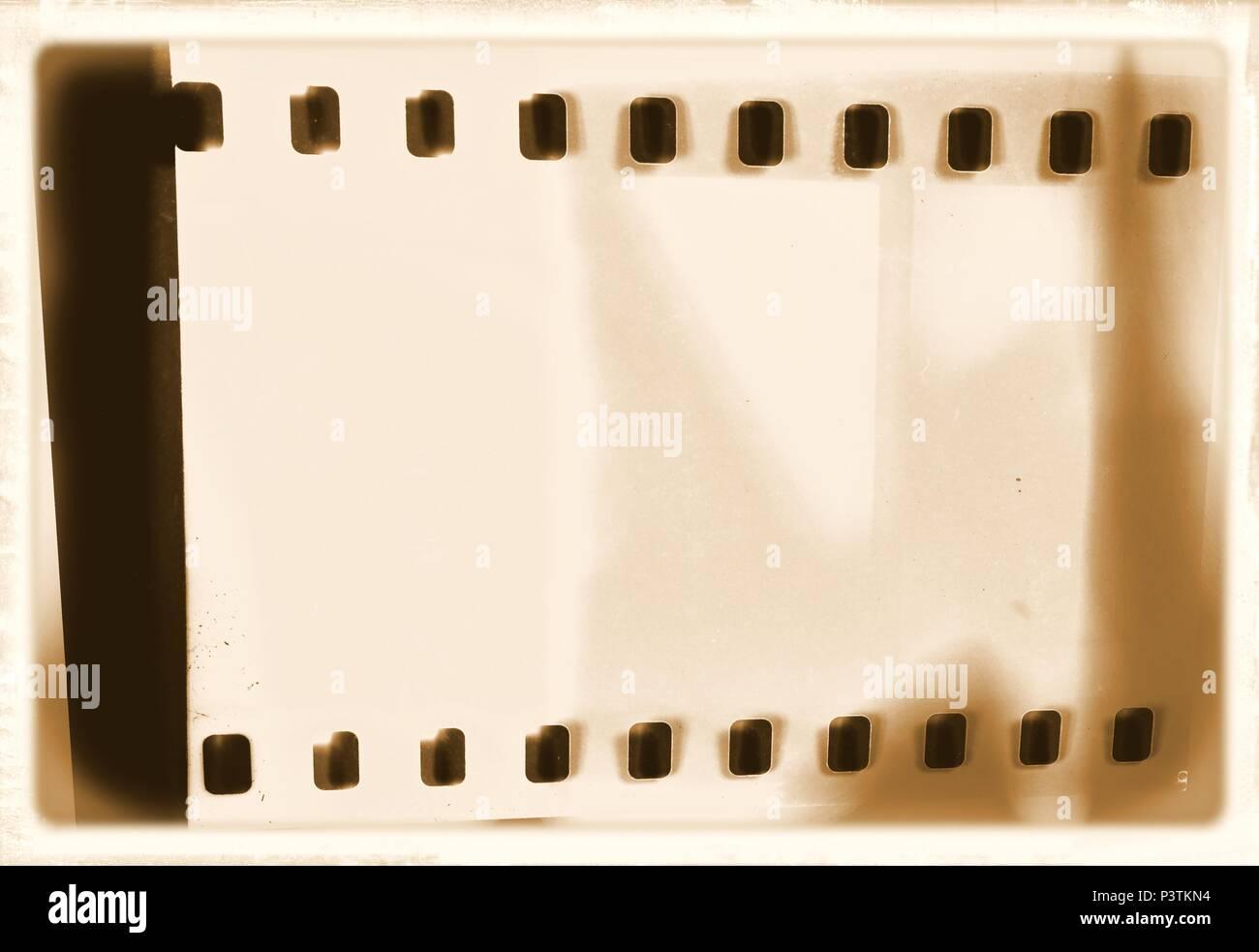 Vintage film strip frame on old and damaged paper background Stock ...