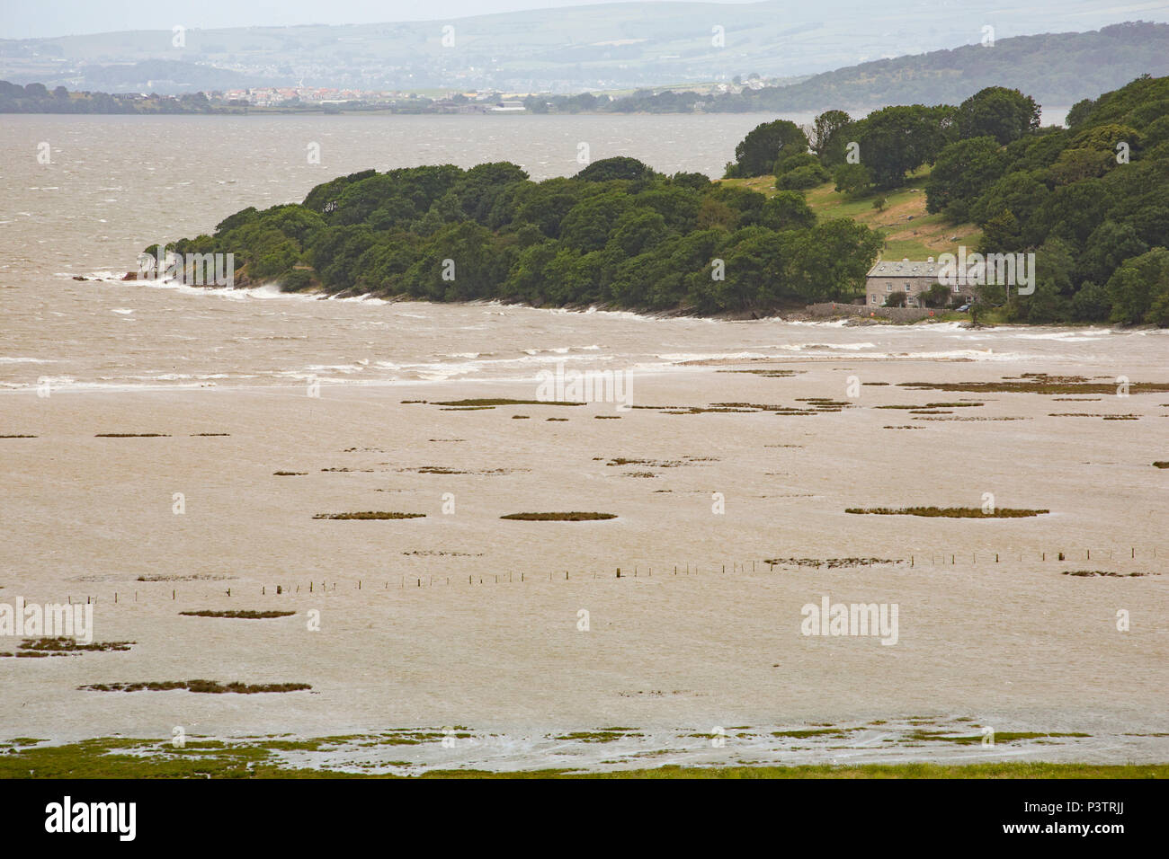 Jenny Brown's Point near Silverdale viewed from Warton Crag as a high tide backed by winds from Storm Hector floods across saltmarshes on the edge of  Stock Photo