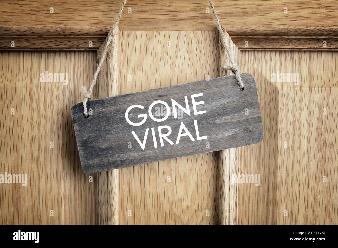 Gone viral sign on office door concept for internet marketing and social networking - Stock Image