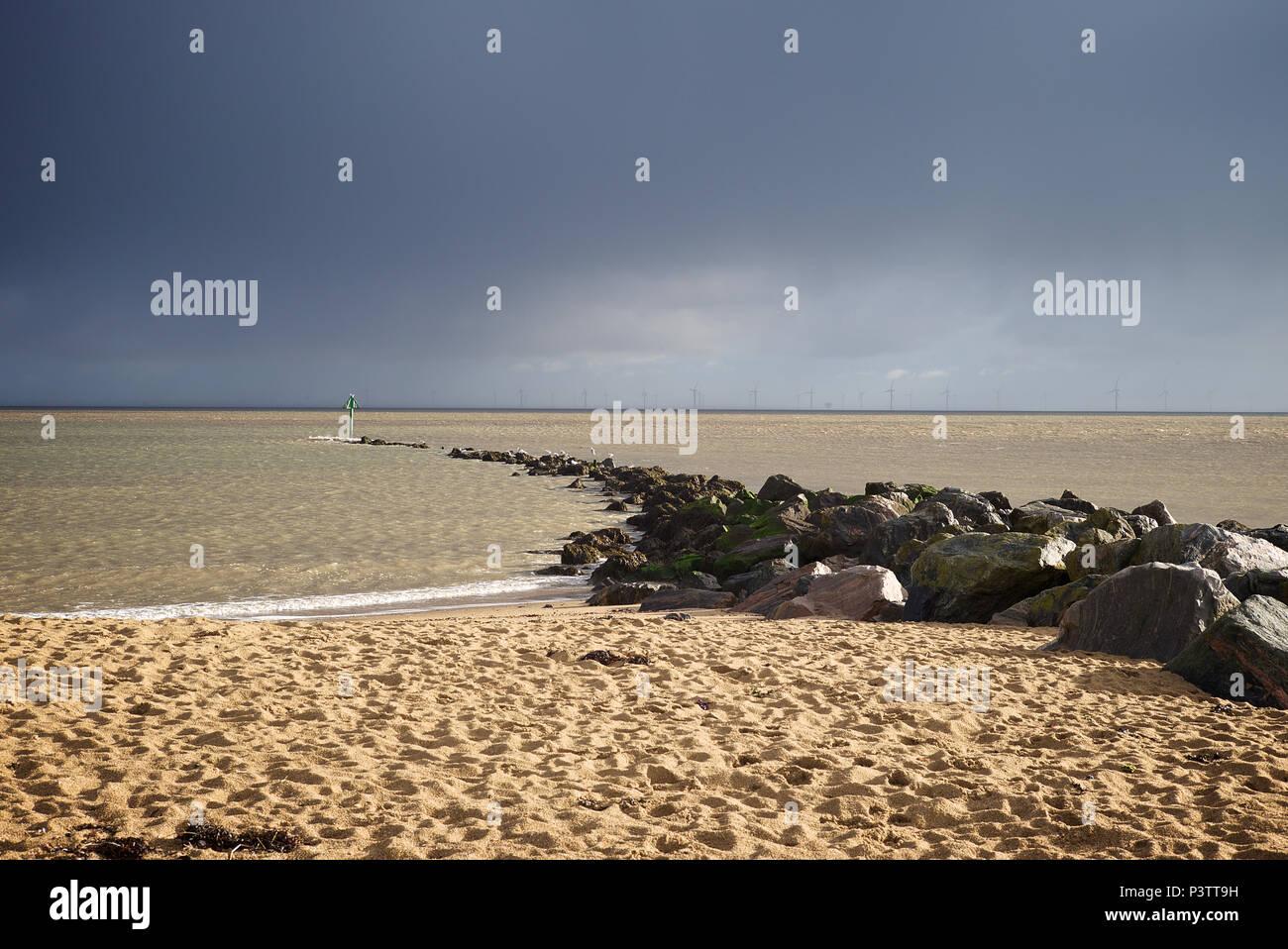 Wind turbines at Gunfleet Sands just off shore of Clacton on Sea Essex. - Stock Image