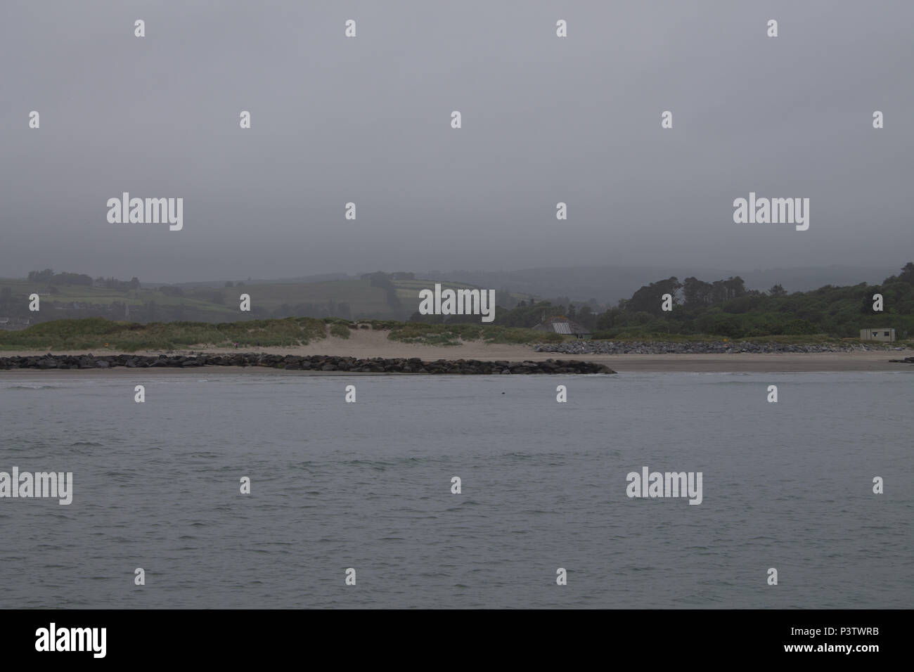 West Cork, Ireland. 19th June, 2018. A grey humid start to the day, with low cloud and mist covering the hilltops nearly down to sea level, with a promise of brighter weather later when the cloud starts to break up. Credit: aphperspective/Alamy Live News - Stock Image