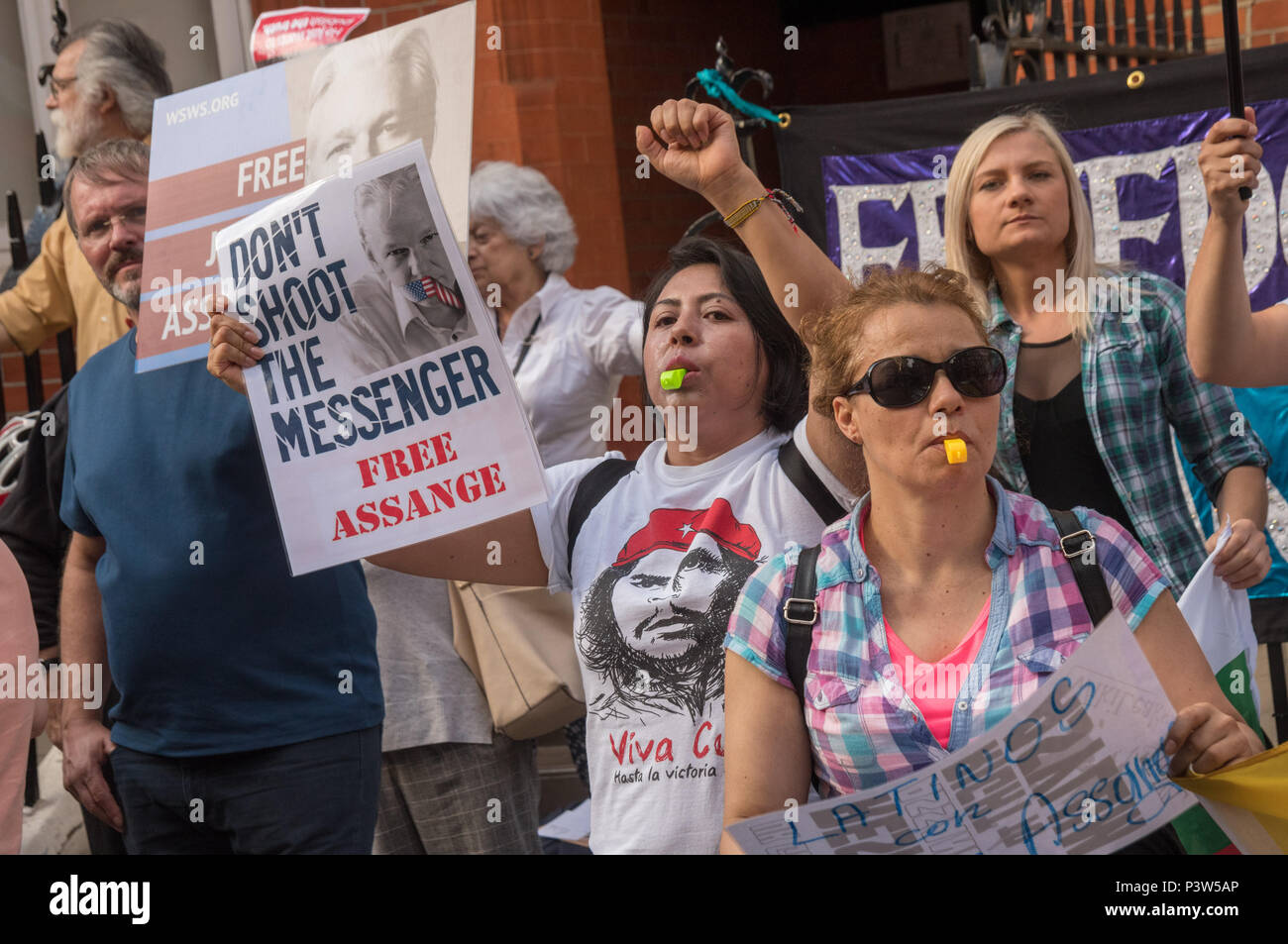 London, UK. 19th June 2018. Ecuadorians at the protest rally outside the Ecuadorian Embassy in London  calling for Julian Assange to be allowed safe passage to the place of his choice to mark six years since he was given asylum there. They called for the UK authorities to allow him to leave the embassy and go to the country of his choice without being arrested. Credit: Peter Marshall/Alamy Live News - Stock Image