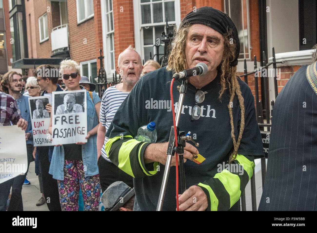 London, UK. 19th June 2018. Ciaron O'Reilly introduces the next speaker at the rally outside the Ecuadorian Embassy in London calling for Julian Assange to be allowed safe passage to the place of his choice to mark six years since he was given asylum there. They called for the UK authorities to allow him to leave the embassy and go to the country of his choice without being arrested. Credit: Peter Marshall/Alamy Live News - Stock Image