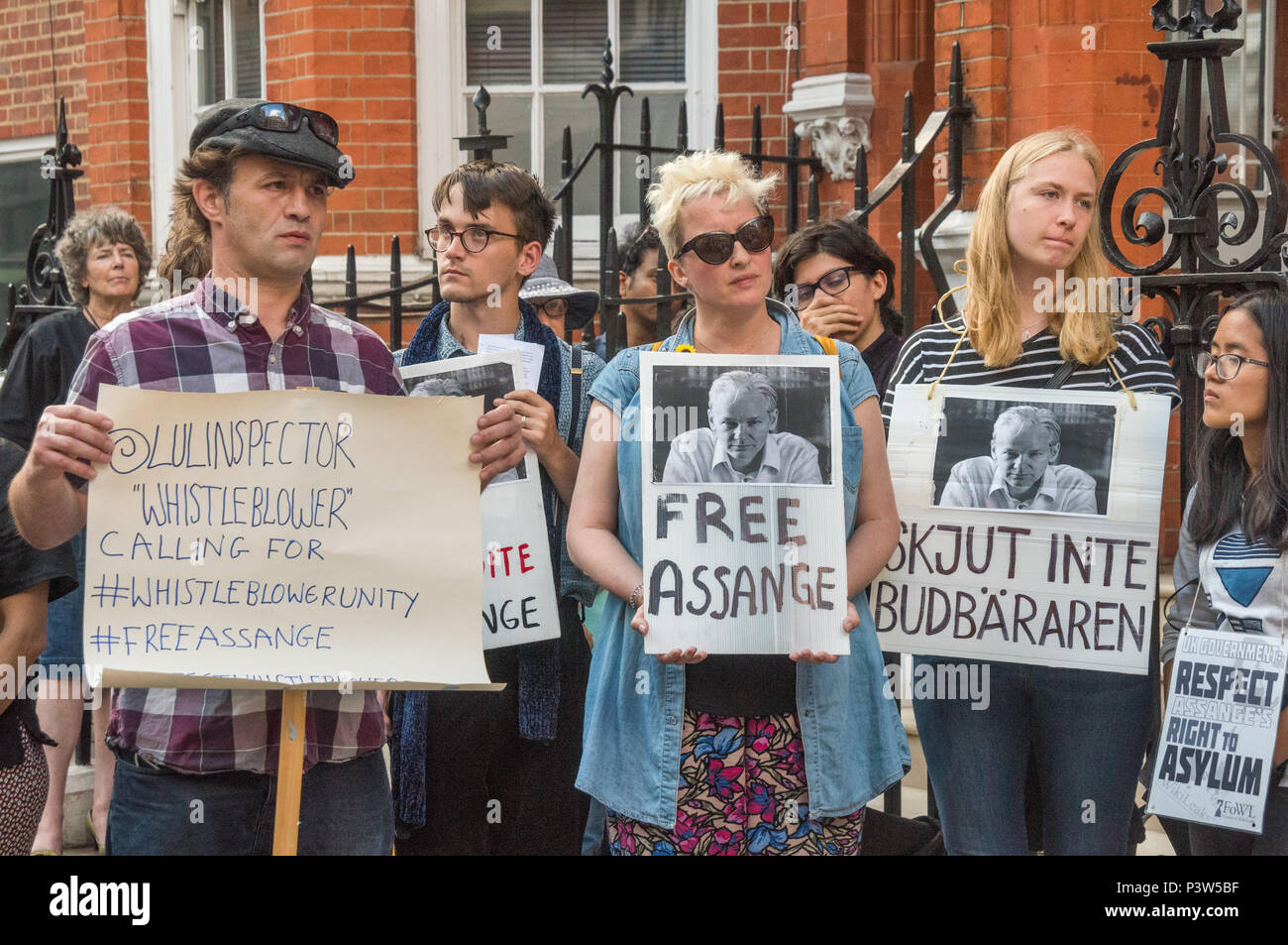 London, UK. 19th June 2018. People at the rally outside the Ecuadorian Embassy in London calling for Julian Assange to be allowed safe passage to the place of his choice to mark six years since he was given asylum there. They called for the UK authorities to allow him to leave the embassy and go to the country of his choice without being arrested. Credit: Peter Marshall/Alamy Live News - Stock Image