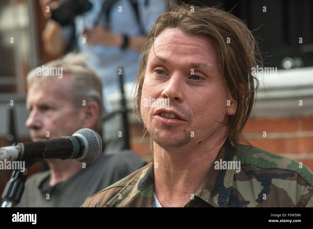 London, UK. 19th June 2018. Lauri Love who succesfully fought extradition to the USA speaks at the rally outside the Ecuadorian Embassy in London calling for Julian Assange to be allowed safe passage to the place of his choice to mark six years since he was given asylum there. They called for the UK authorities to allow him to leave the embassy and go to the country of his choice without being arrested. Credit: Peter Marshall/Alamy Live News - Stock Image