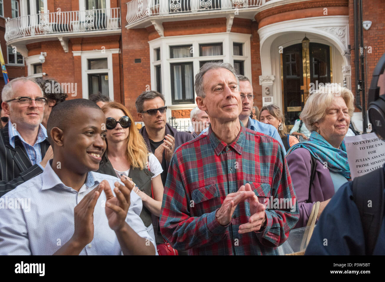 London, UK. 19th June 2018. Peter Tatchell ended his speech at the rally outside the Ecuadorian Embassy in London by leading a long round of applause for Julian Assange. The rally called for him to be allowed safe passage to the place of his choice to mark six years since he was given asylum there. They called for the UK authorities to allow him to leave the embassy and go to the country of his choice without being arrested. Credit: Peter Marshall/Alamy Live News - Stock Image