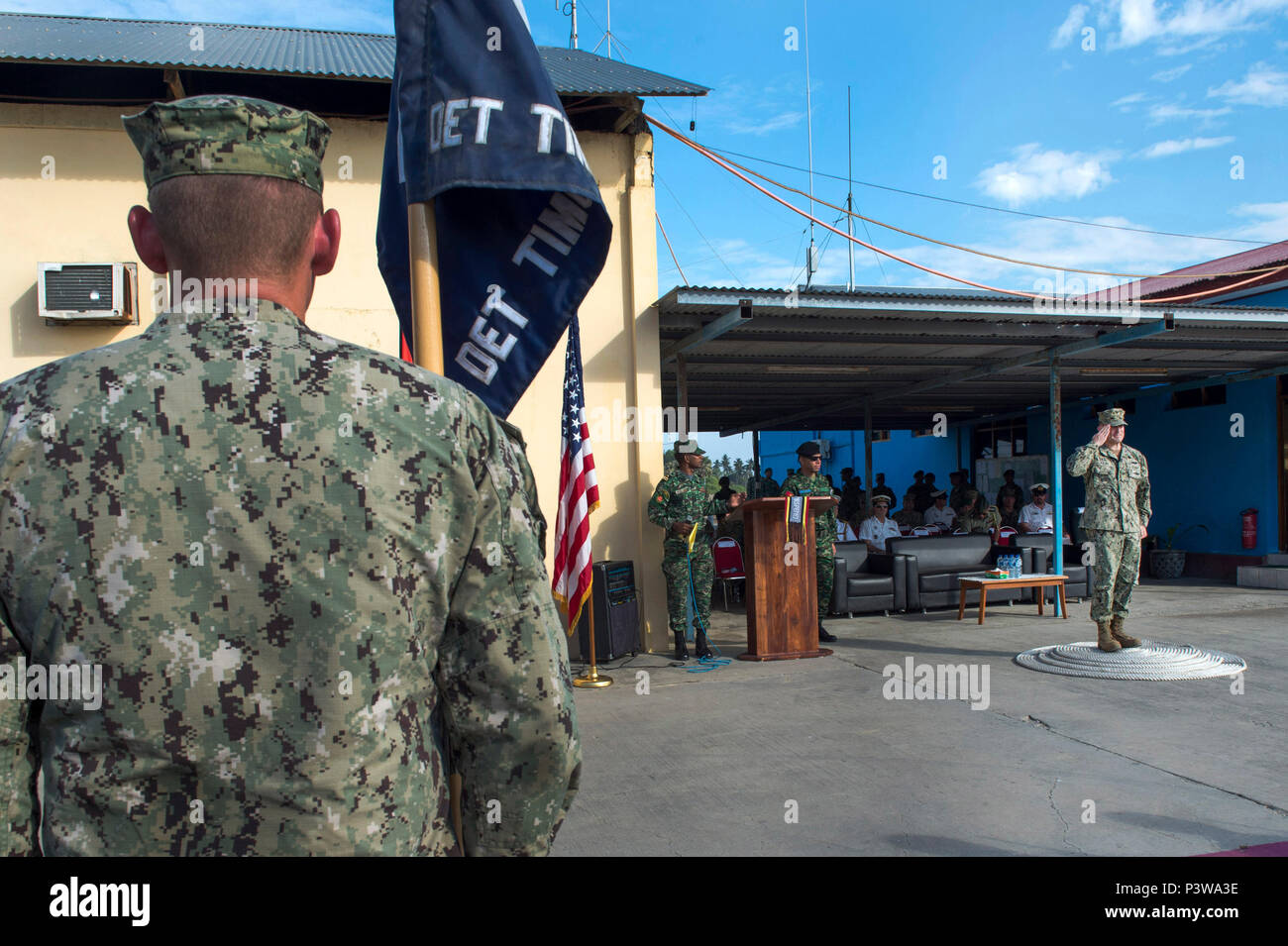 160801-N-DH124-020 DILI, Timor Leste (Aug. 1, 2016) - Capt. Jeffrey Killian, commodore, 30th Naval Construction Regiment, salutes U.S. Navy, U.S. Marine Corps and Forsa Defesa Timor Leste (F-FDTL) service members during the opening ceremony for Cooperation Afloat Readiness and Training (CARAT) Timor-Leste 2016 at the Port Hera Naval Base. The focus of CARAT is developing maritime security capabilities and increasing interoperability among participants. Skill areas exercised during CARAT include Maritime Interdiction Operations; riverine, amphibious and undersea warfare operations; diving and s Stock Photo
