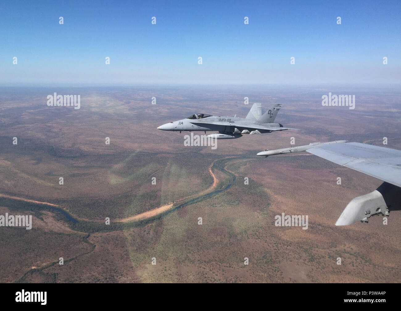 F/A-18C Hornets with Marine Fighter Attack Squadron (VMFA)122 conduct air operations during Exercise Pitch Black 2016 at Royal Australian Air Force Base Tindal, Australia, July 25, 2016. Pitch Black 16 is a biennial, three week, multinational, large-force training exercise hosted by RAAF Tindal. The allied nation squadrons will execute day and night flights from Tindal to Darwin, while performing large force offensive counter-air and offensive air support operations throughout the exercise. (U.S. Marine Corps courtesy photo) - Stock Image