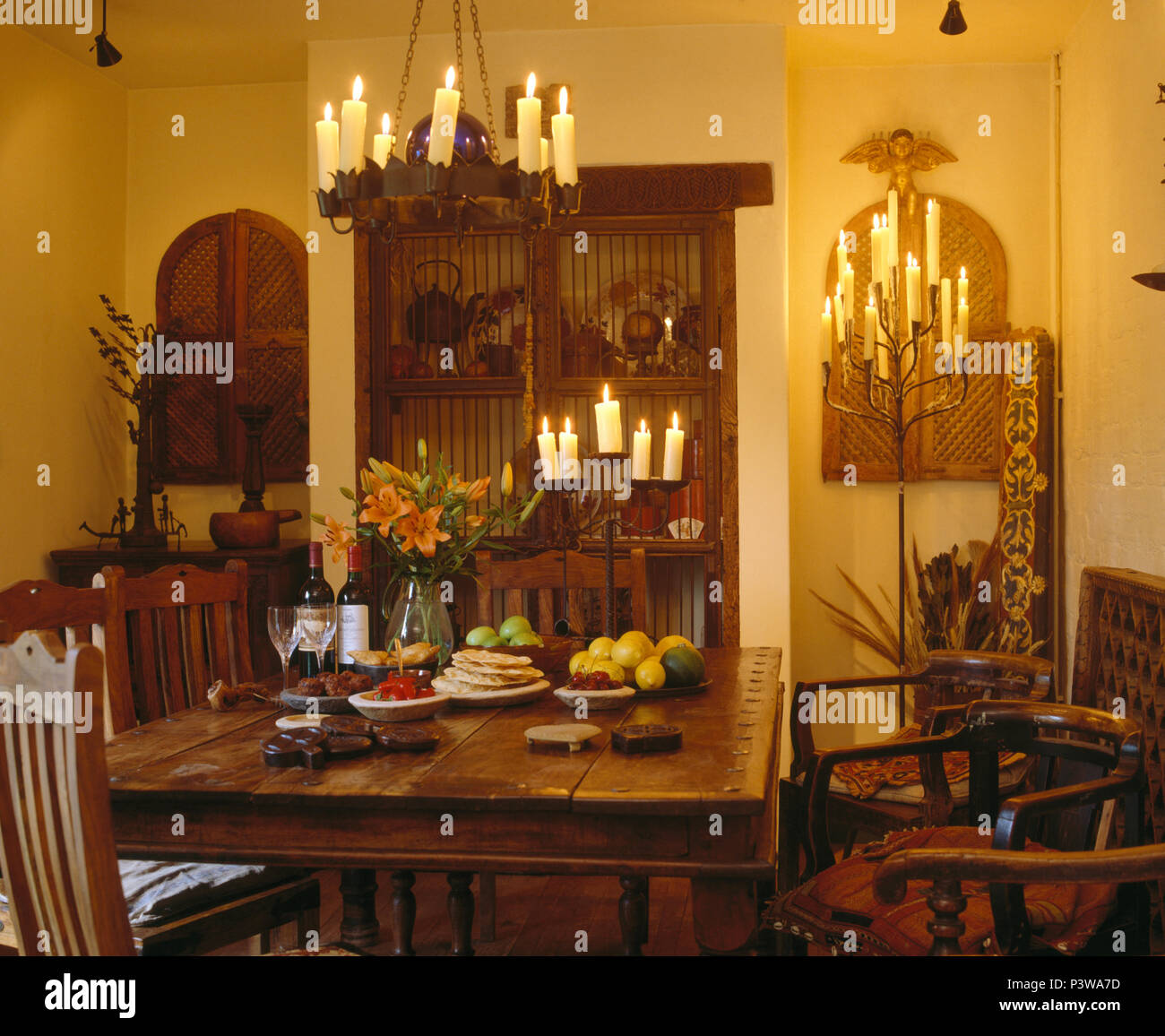 Magnificent Lighted Candles In Chandelier Above Table In Country Dining Beutiful Home Inspiration Xortanetmahrainfo