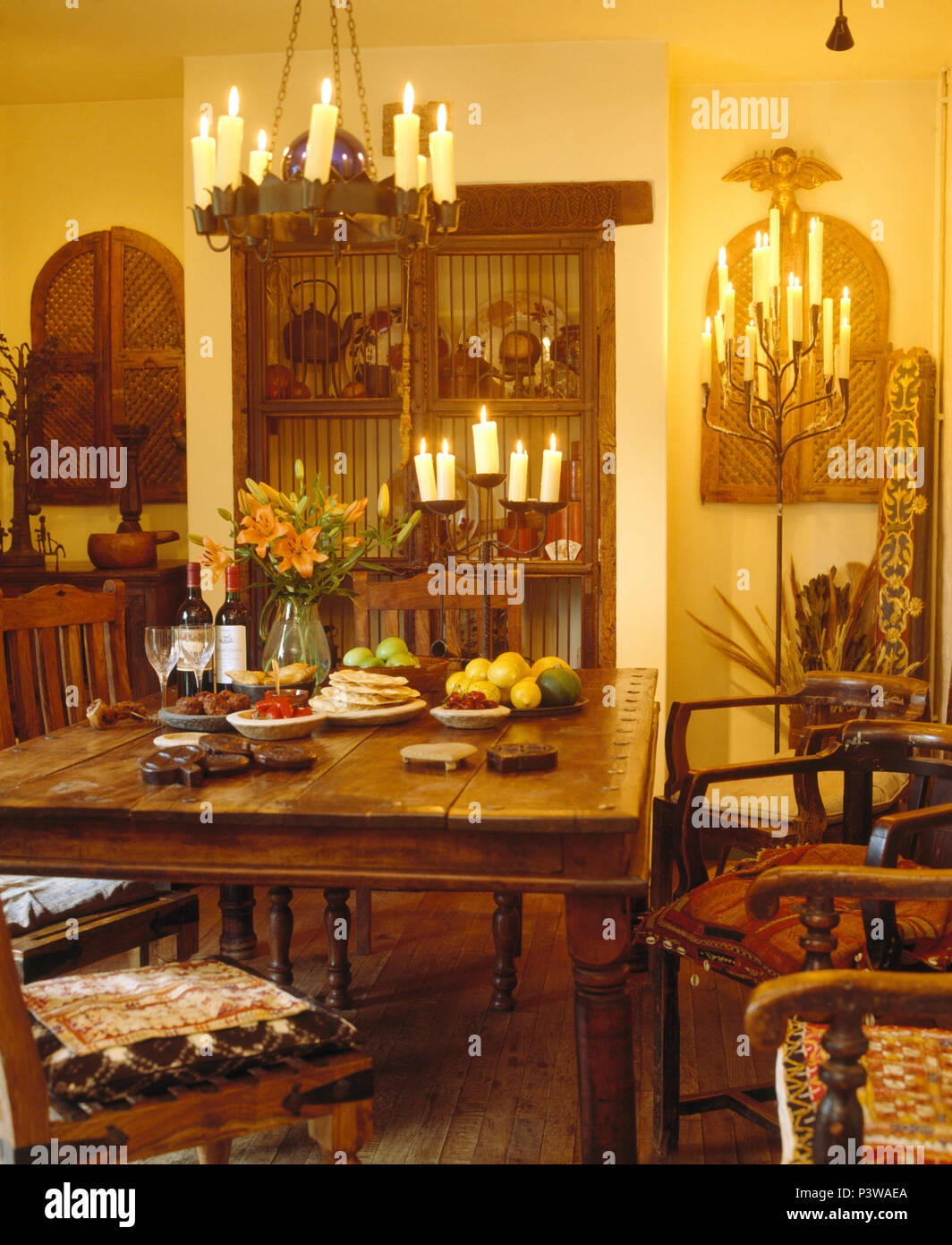 Surprising Lighted Candles In Chandelier Above Table In Country Dining Beutiful Home Inspiration Xortanetmahrainfo