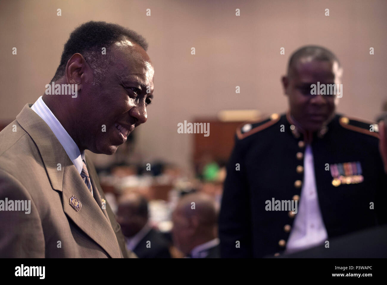 Col. Reginald L. Hairston talks with fraternity members during the Omega Psi Phi Fraternity's 80th Grand Conclave in Las Vegas July 23. This event gave the Marine Corps the opportunity to engage with qualified officer prospects and key influencers. - Stock Image