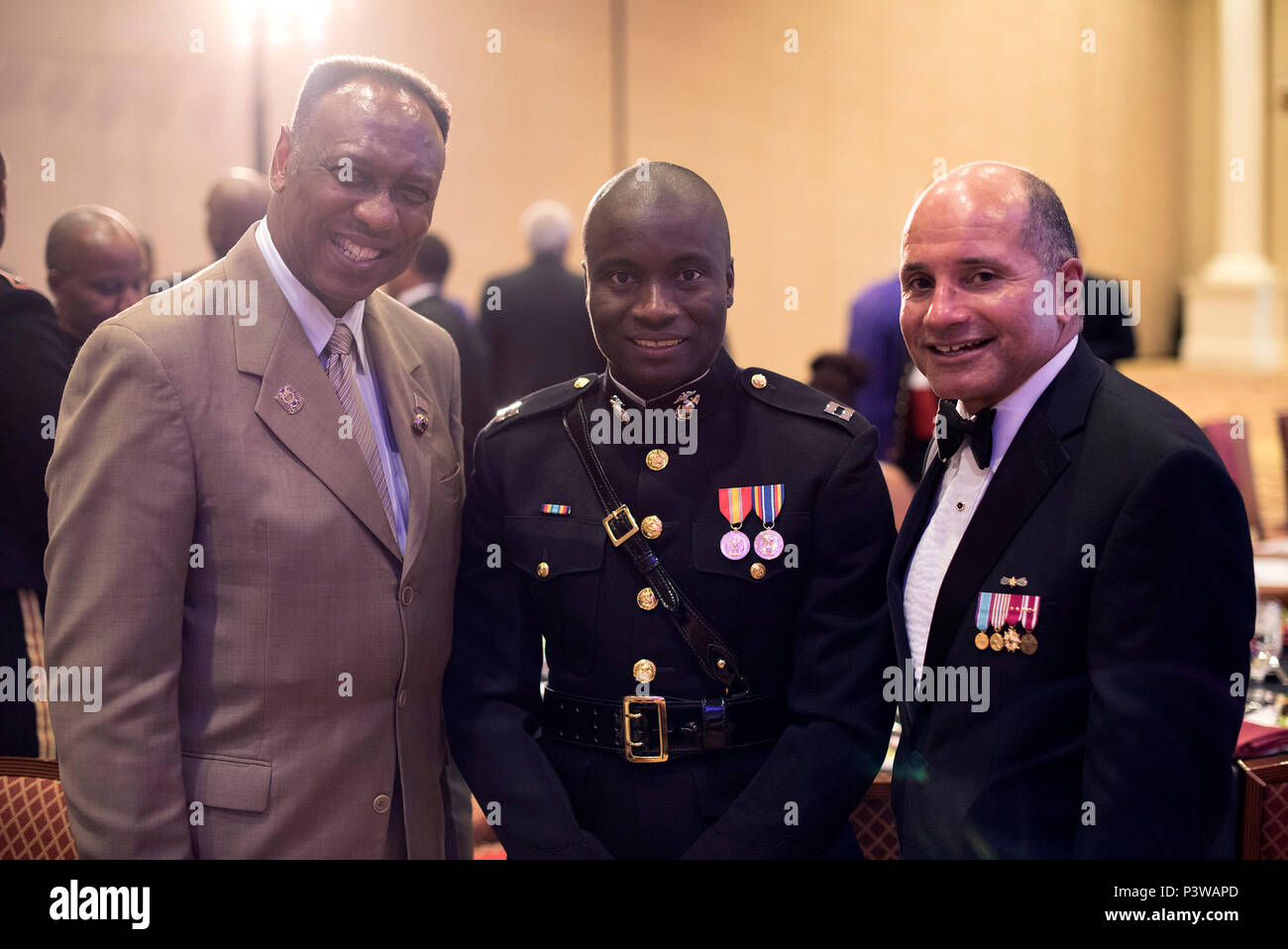Capt. Nubari Kogbara talks with fraternity members during the Omega Psi Phi Fraternity's 80th Grand Conclave in Las Vegas July 23. This event gave the Marine Corps the opportunity to engage with qualified officer prospects and key influencers. - Stock Image