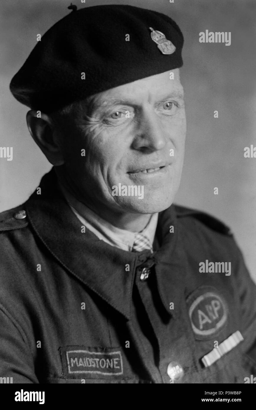 Man in ARP (Air Raid Patrol) uniform. This image was taken during the 1940s in Maidstone, Kent. Stock Photo