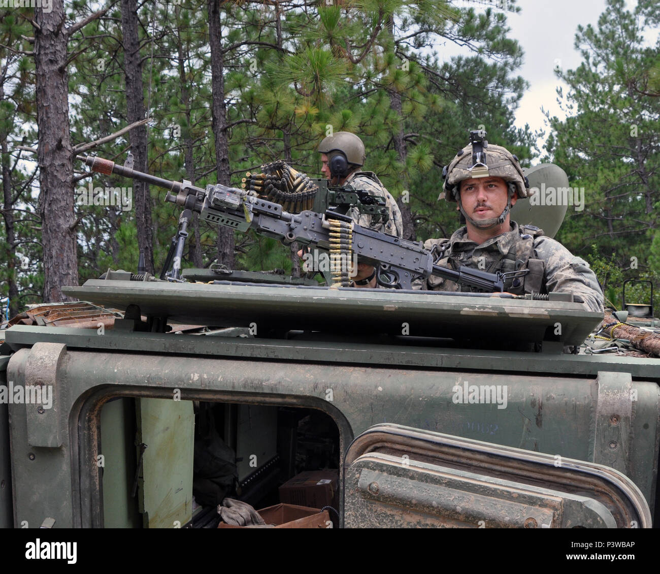 Ohio Army National Guard Sgt. Adam Fullmer, a team leader assigned to 812th Engineer Company based in Wooster, Ohio, provides security for his unit in a M113 armored personnel carrier during training at the Army's Joint Readiness Training Center, Fort Polk, Louisiana, July 27, 2016. Approximately 3,000 Soldiers from New York joined 2,000 other state Army National Guard units, active Army and Army Reserve troops as part of the 27th Infantry Brigade Combat Team's Task Force Hunter, July 9-30, 2016.  The Soldiers are honing their skills and practicing integrating combat operations ranging from in Stock Photo