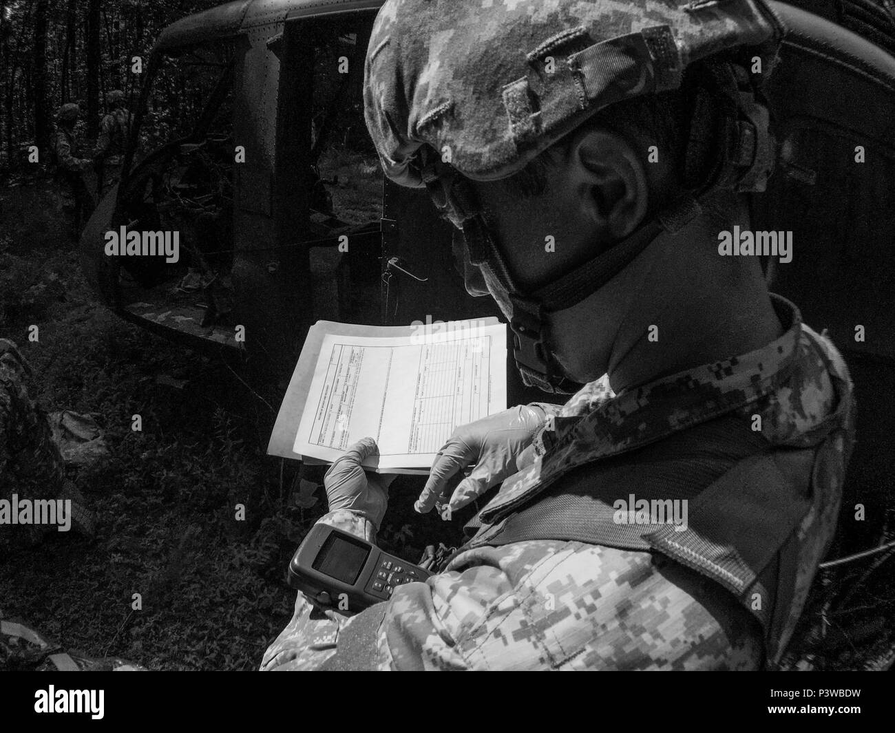 A U.S. Army Reserve soldier with the 246th Quartermaster Company (Mortuary Affairs), Mayaguez, Puerto Rico, pulls GPS coordinates for a search and recovery report at a simulated helicopter crash during Mortuary Affairs Exercise 16-02, July 21, at Fort Pickett, Va. MAX 16-02 included all six U.S. Army Reserve Mortuary Affairs units performing search and recovery missions and operating Mortuary Affairs Collection Points and a Theater Mortuary Evacuation Point. The units were evaluated by active-duty mortuary affairs personnel from nearby Fort Lee, Va. (U.S. Army photo by Timothy L. Hale)(Release - Stock Image