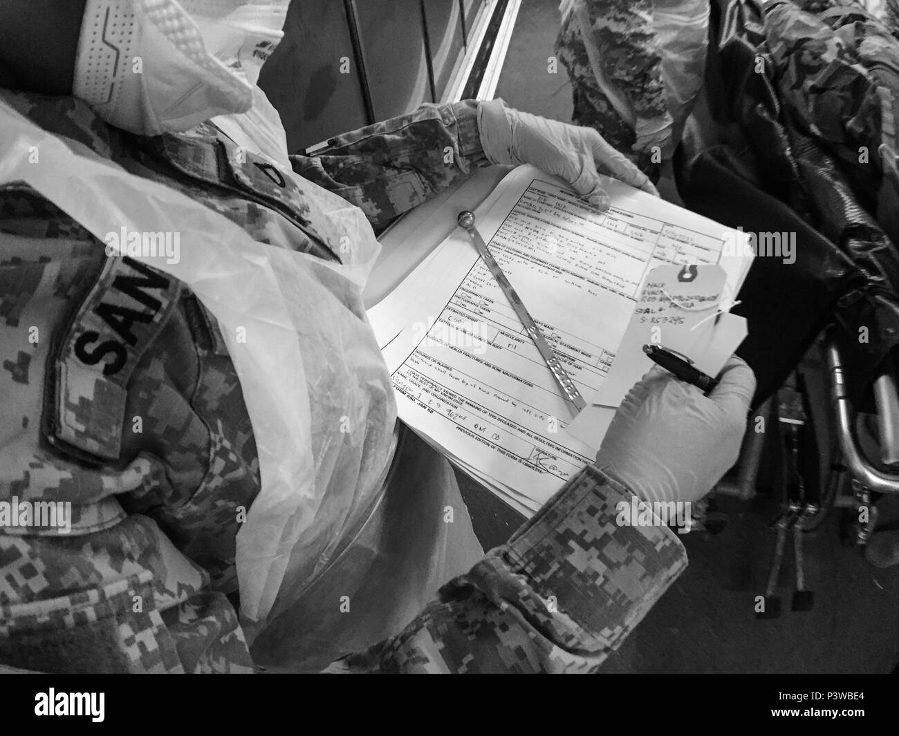 A soldier with the U.S. Army Reserve's 962nd Quartermaster Company (Mortuary Affairs) based in Guam, prepares the final paperwork, tags, and identification lock, that will be placed on a simulated human remains pouch, during Mortuary Affairs Exercise 16-02, July 22, at Fort Pickett, Va. MAX 16-02 included all six U.S. Army Reserve Mortuary Affairs units performing search and recovery missions and operating Mortuary Affairs Collection Points and a Theater Mortuary Evacuation Point. The units were evaluated by active-duty mortuary affairs personnel from nearby Fort Lee, Va. (U.S. Army photo by T - Stock Image
