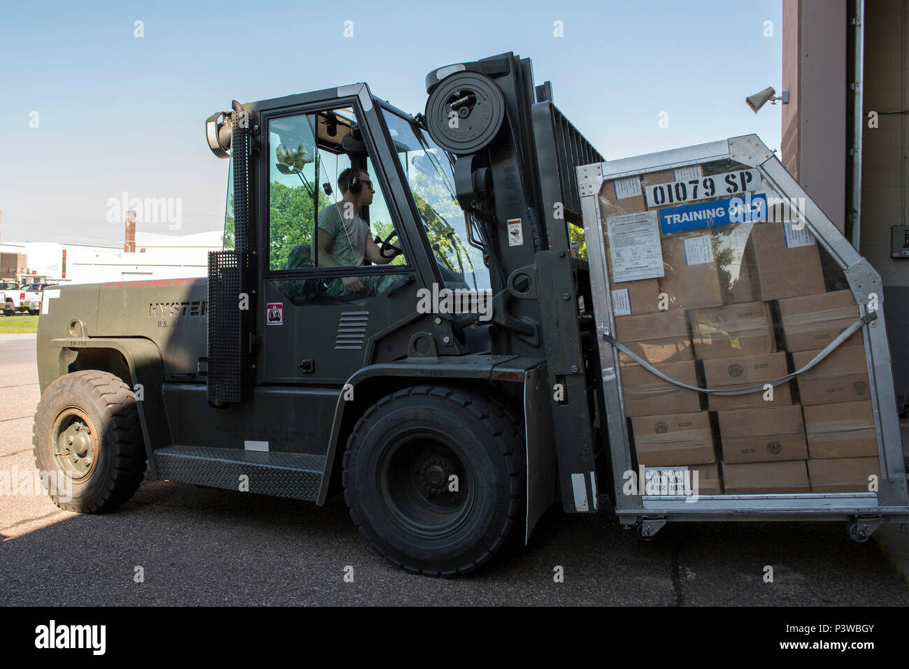 U.S. Air Force Senior Airman Alex Byrne, assigned to the Logistics Readiness Squadron, 158th Fighter Wing, Vermont National Guard, drives a forklift carrying medical countermeasure supplies during Vigilant Guard 2016, at the Burlington International Airport, South Burlington, Vt., July 27, 2016. Vigilant Guard is a national level emergency response exercise, sponsored by the National Guard and NORTHCOM, which provides National Guard units an opportunity to improve cooperation and relationships with regional civilian, military, and federal partners in preparation for emergencies and catastrophi Stock Photo