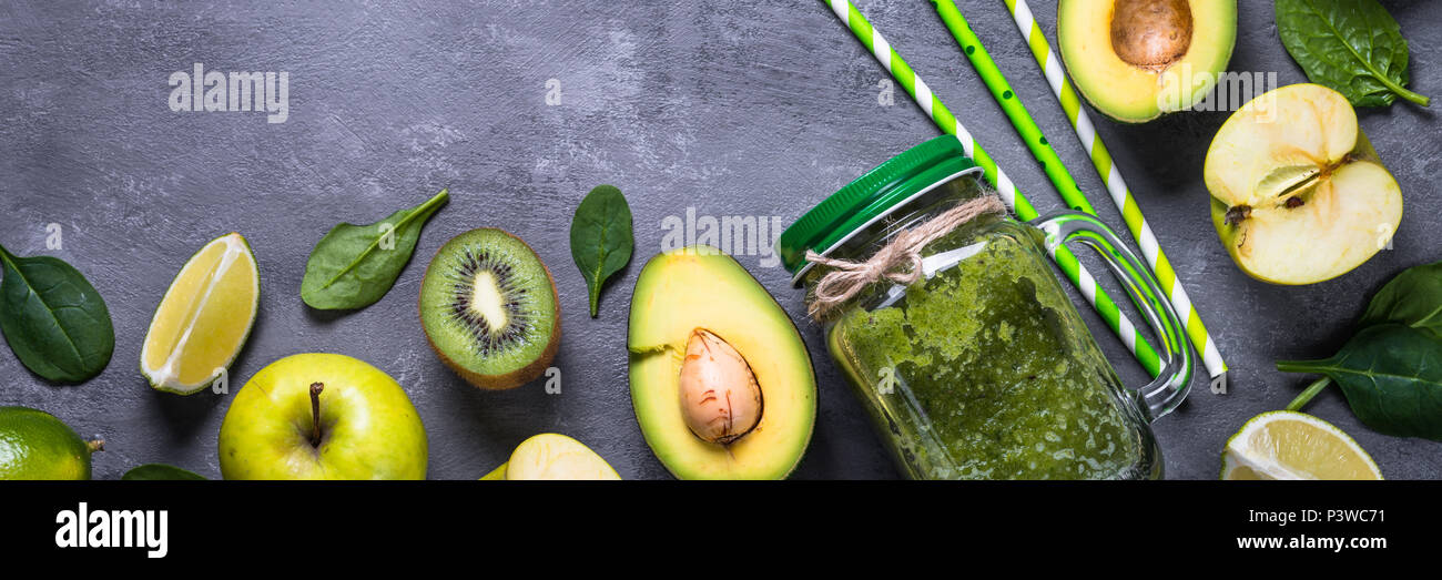 Green food background on stone table top view. Superfoods, detox, diet, healthy food. Long banner format. - Stock Image
