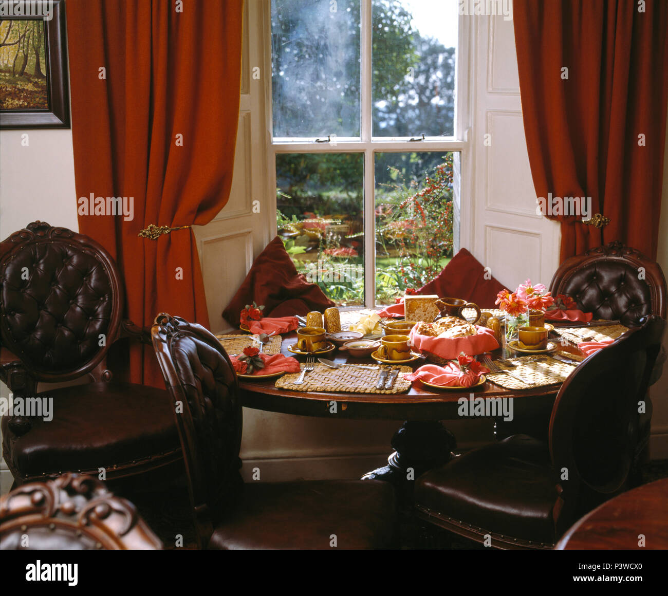 Victorian Button Back Leather Chairs At Table In Front Of Window With Red  Curtains In Victorian Style Dining Room