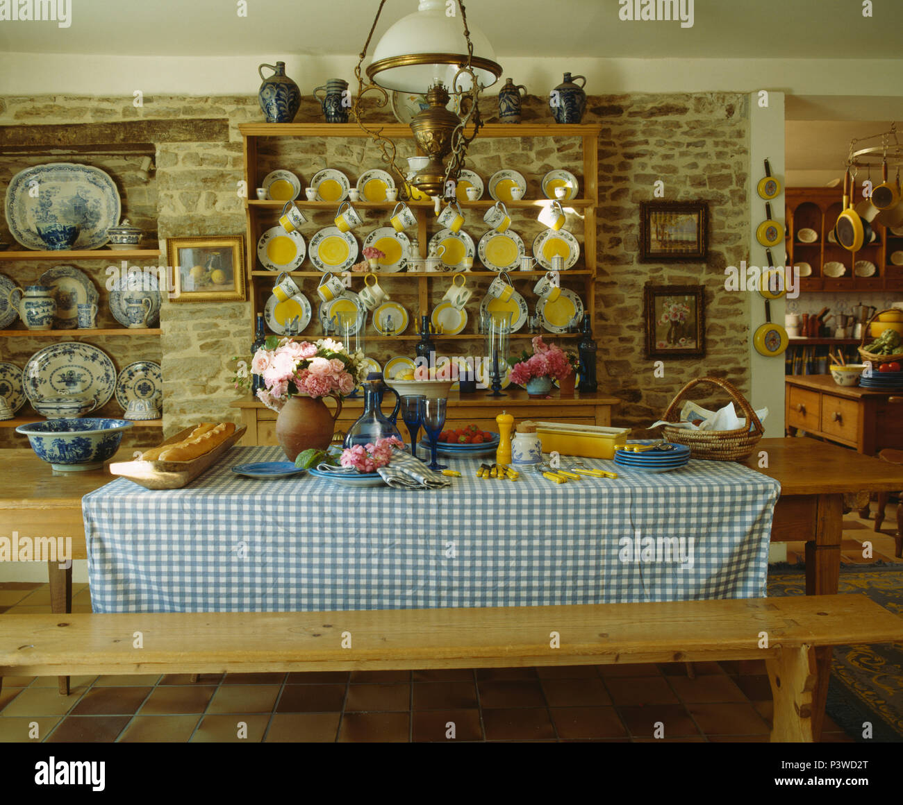 Rustic Wooden Bench At Table With Blue Checked Cloth In French
