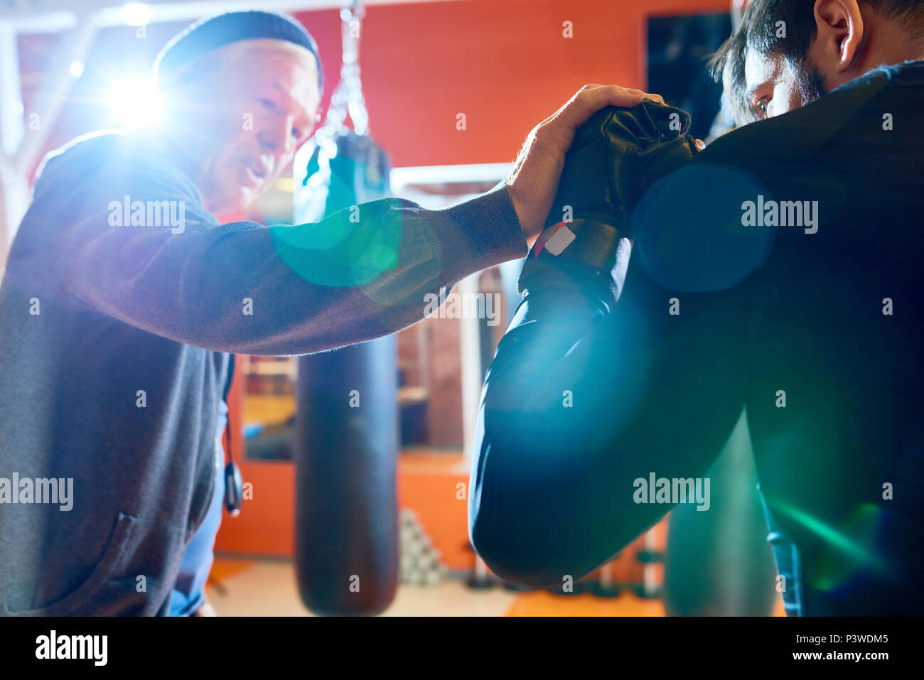 Trainer showing techniques to boxer Stock Photo
