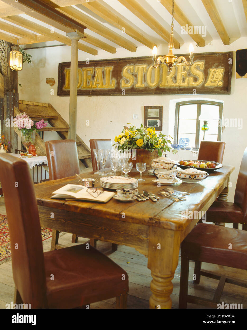 Old store sign on wall in country dining room with ...