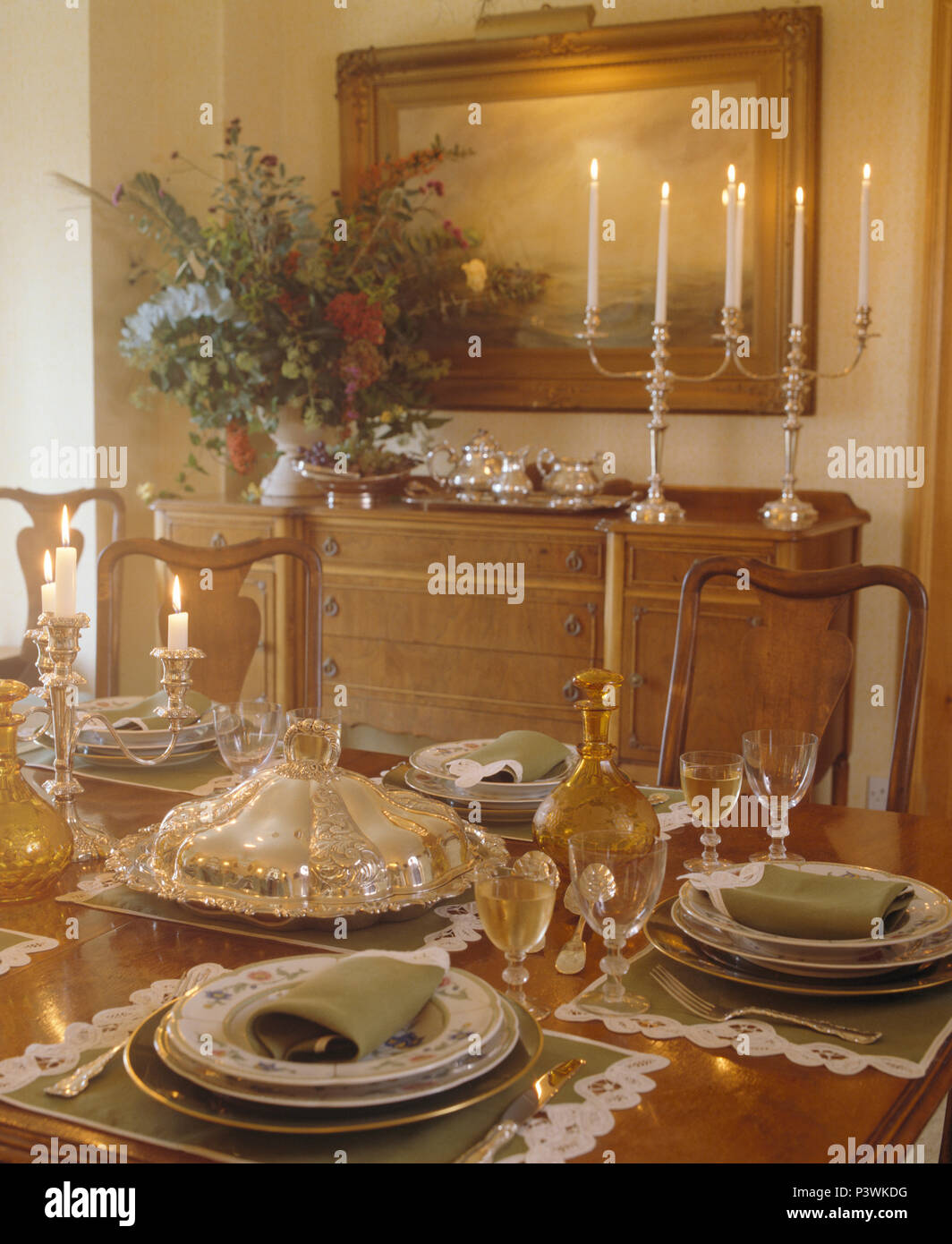 Antique Glassware And Silver Tureen On Table Set For Lunch In Country Dining Room With Silver Candlesticks On Sideboard