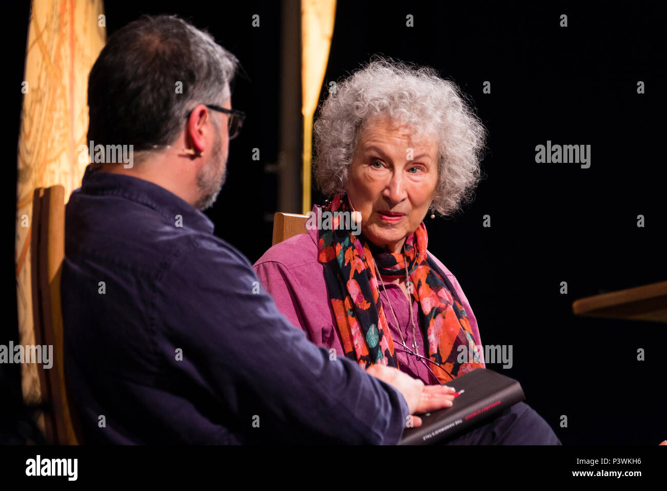 Margaret Atwood, acclaimed Canadian poet, novelist, literary critic, essayist, inventor, teacher and environmental activist.  Pictured talking to Peter Florence, Festival director, at the 2018 Hay Festival of Literature and the Arts.  The annual festival  in the small town of Hay on Wye on the Welsh borders , attracts  writers and thinkers from across the globe for 10 days of celebrations of the best of the written word, political though  and literary debate - Stock Image