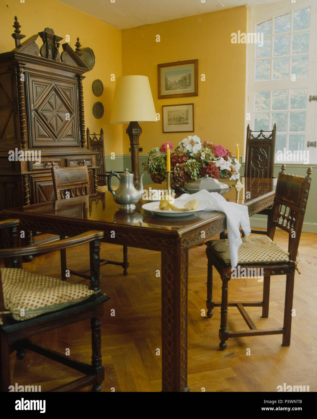 Parquet Flooring And Dark Wood Furniture In Yellow French Country Dining  Room