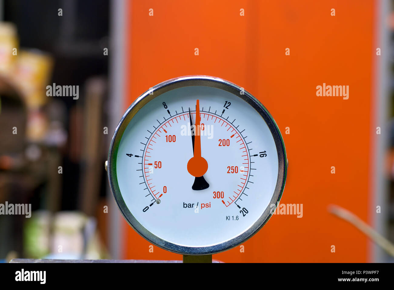 A 0 - 300 psi pressure gauge attached to an industrial boiler. - Stock Image