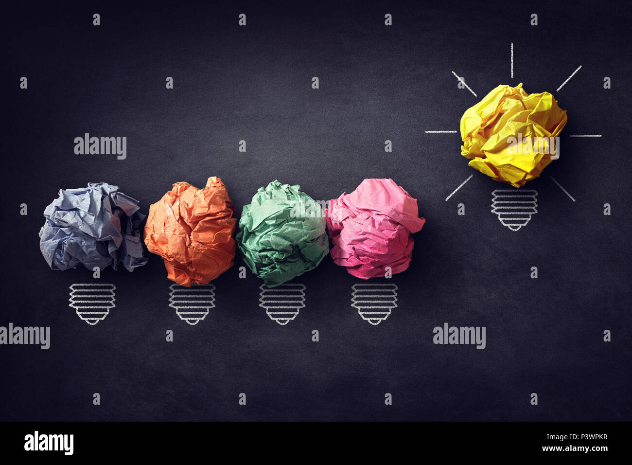 Good idea concept crumpled paper ball lightbulb on blackboard - Stock Image