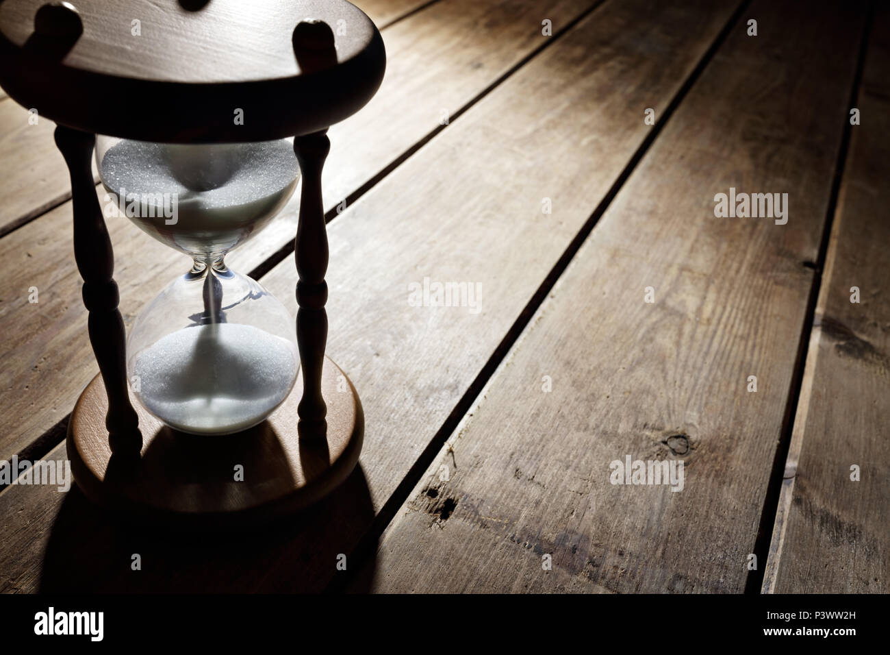Hourglass time passing concept for business deadline, urgency and running out of time - Stock Image