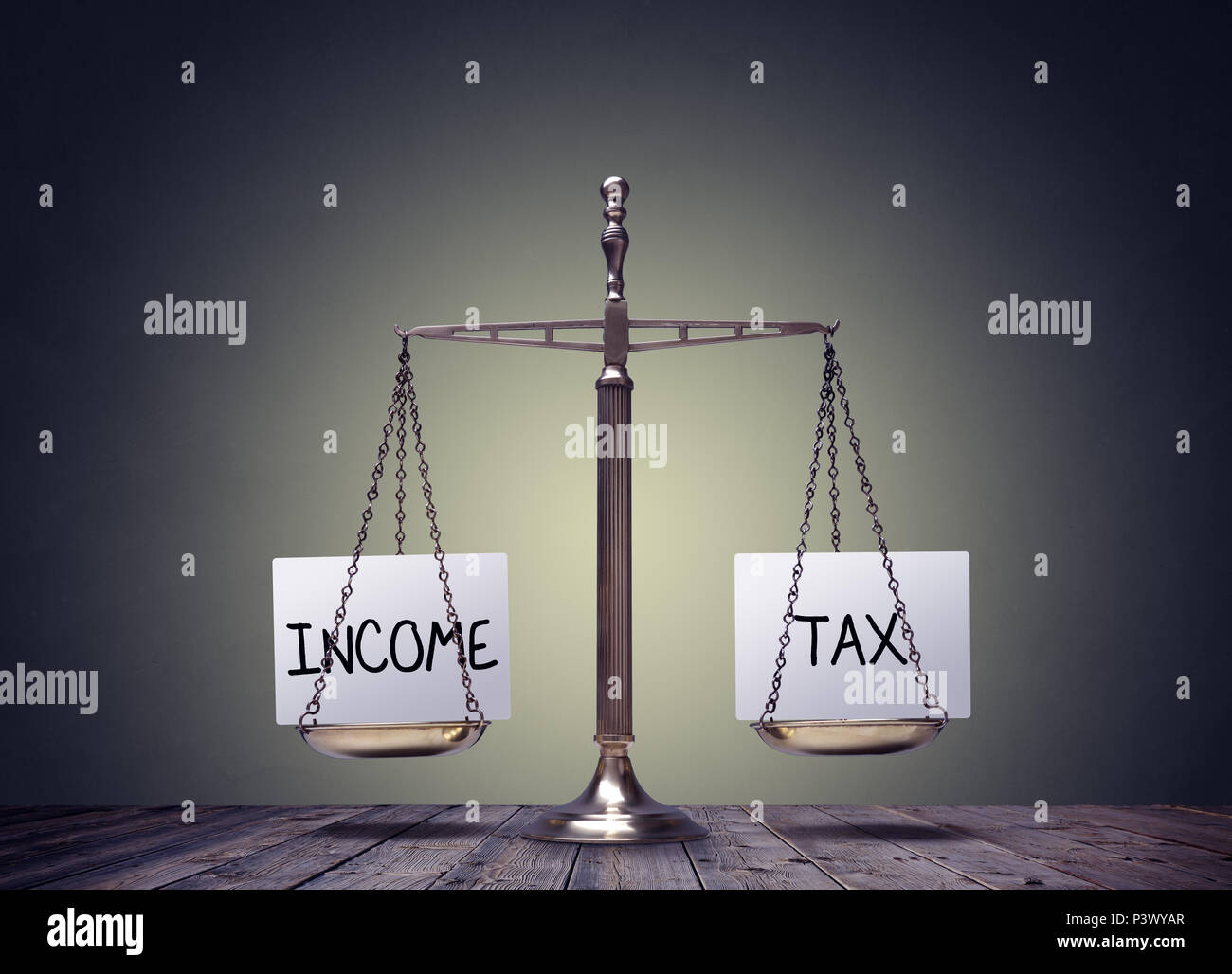 Income tax balance finance books scales concept - Stock Image