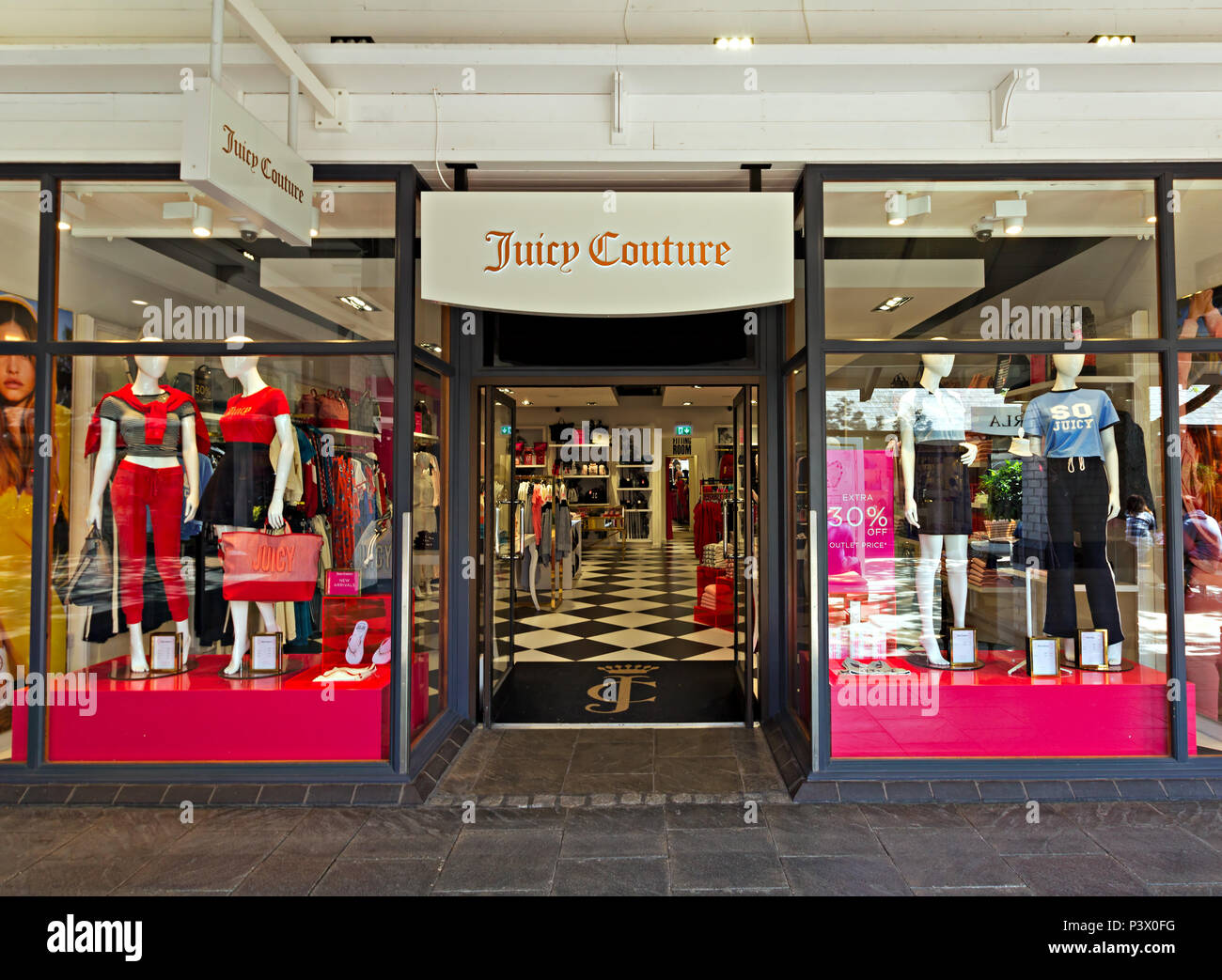 Shop frontage of the Juicy Couture store at the Cheshire Oaks Designer Outlet, Ellesmere Port Cheshire. - Stock Image