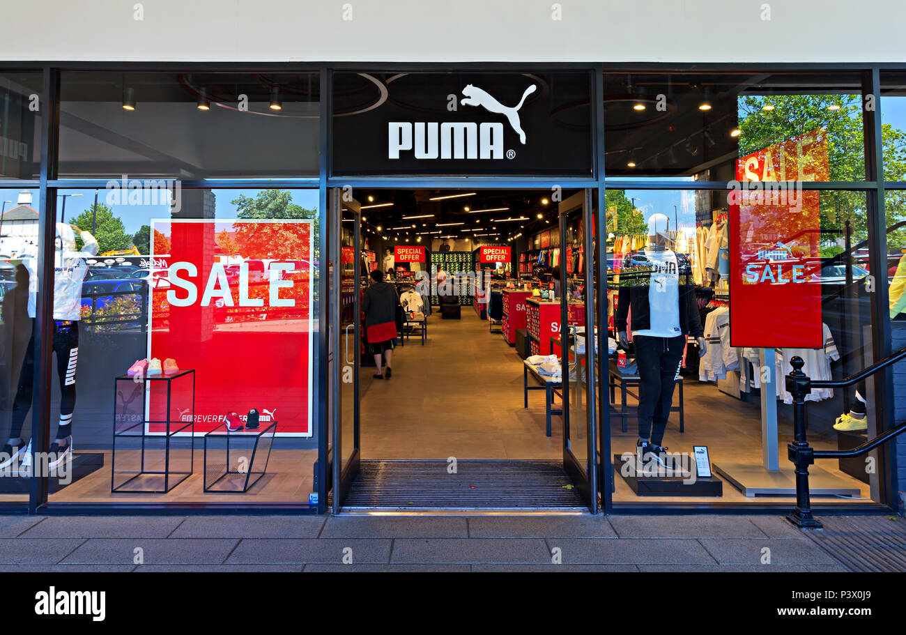 d34a98391af Shop frontage of the Puma store at the Cheshire Oaks Designer Outlet,  Ellesmere Port Cheshire