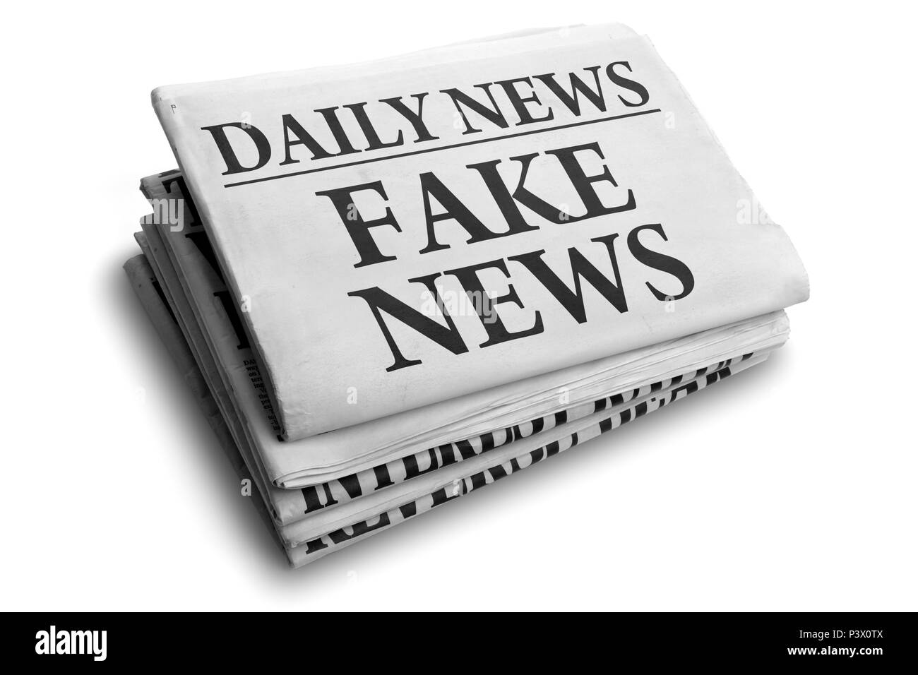 Daily news newspaper headline reading fake news concept for false event news headline - Stock Image