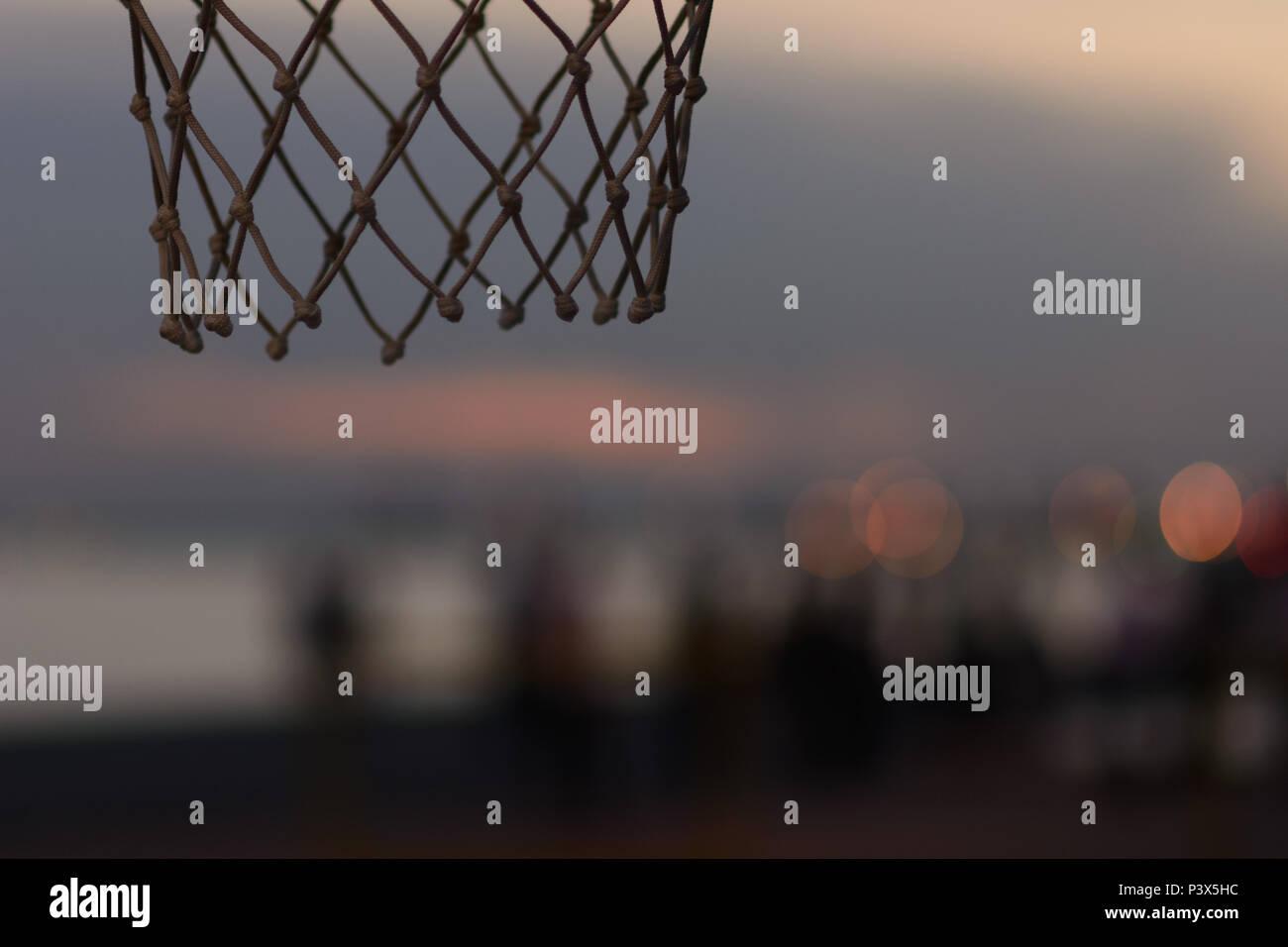 basketball hoop sunset - Stock Image