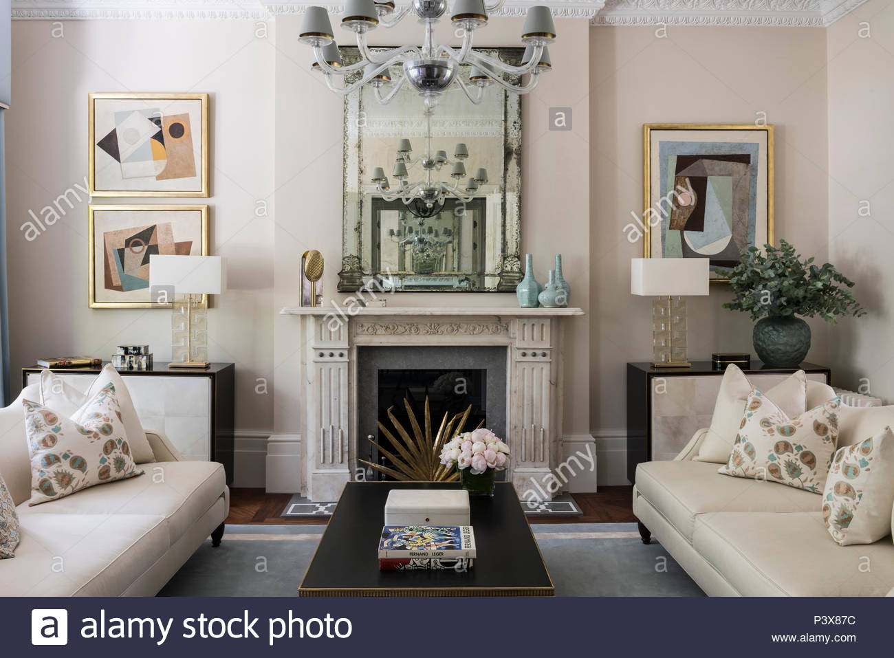Contemporary artworks by Jeremy Annear add to the symmetry of the sitting room - Stock Image
