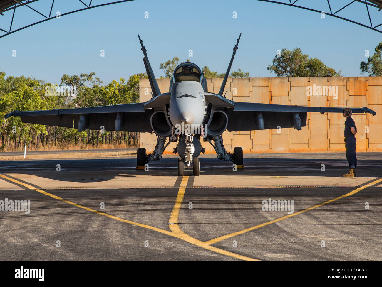 An F/A-18C Hornet assigned to Marine Fighter Attack Squadron (VMFA) 122 prepares to taxi during Exercise Pitch Black 2016 at Royal Australian Air Force Base Tindal, Australia, July 22, 2016. The flying squadron executed large force close air support, air interdiction, armed reconnaissance, and strike coordination and reconnaissance missions over the three week training evolution. The biennial, multinational exercise involves approximately 10 allied nations and prepares these forces for possible real-world scenarios. The bilateral effort amongst Exercise Pitch Black 2016 furthermore showcases t - Stock Image