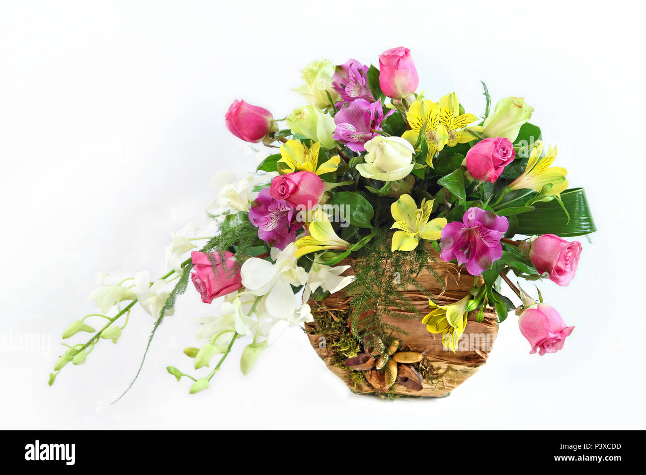 Floral Arrangement In Natural Vase Isolated On A White Background