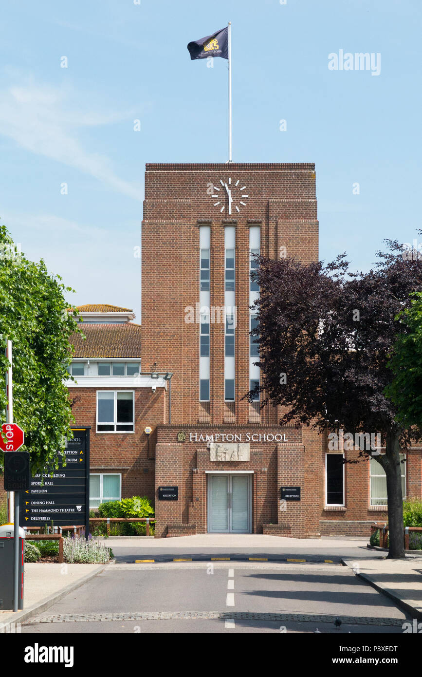 Front exterior facade of Hampton School with flag flying. It is an independent day school for boys in Hampton, London. UK (99) - Stock Image