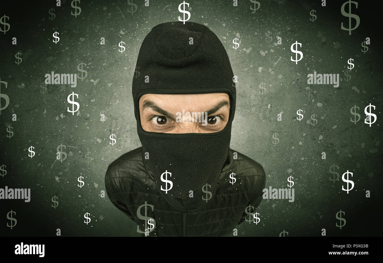Money hungry thief in black clothes and tolls on his hand. Stock Photo
