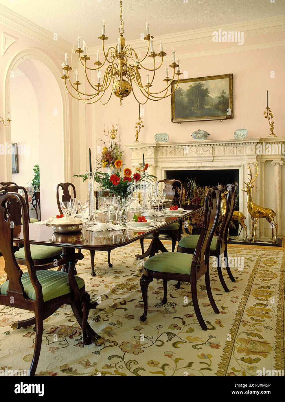 Chandelier over antique mahogany dining table and chairs in grand dining  room with pale patterned rug - Chandelier Over Antique Mahogany Dining Table And Chairs In Grand