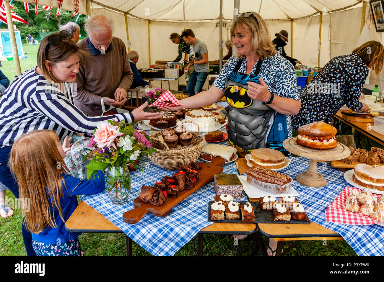 People Buying Cakes At A Traditional Village Fete, High Hurstwood, Sussex, UK - Stock Image