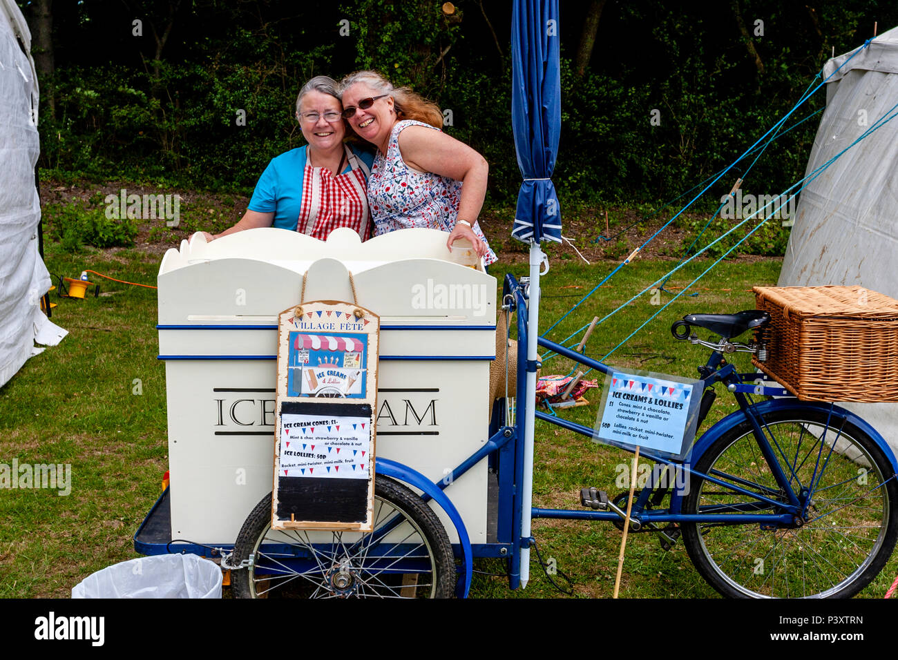 Local Women Selling Ice Creams At The Annual High Hurstwood Village Fete, Sussex, UK - Stock Image
