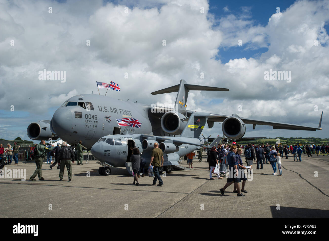 "Attendees of the Yeovilton, England crowd around the 315th Airift Wing's mini C-17 and a Charleston C-17 Globemaster III July 2. This was the mini C-17's first trip across the pond and was a huge hit at Yeovilton Air Day 2016. This is the 315th AWs second time visiting Royal Naval Air Station Yeovilton, England, and the mighty presence of the mini C-17 helped seal the deal for another ""Best Static Display"" award. The miniature C-17 has been used all across the United States to promote the Air Force Reserve and bolster recruiting efforts at air shows, parades and other community events. (U.S. A - Stock Image"
