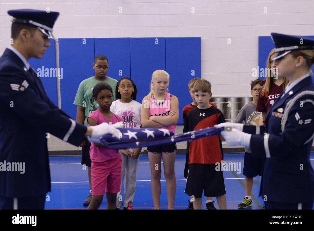 Military children watch Airmen from the base Honor Guard