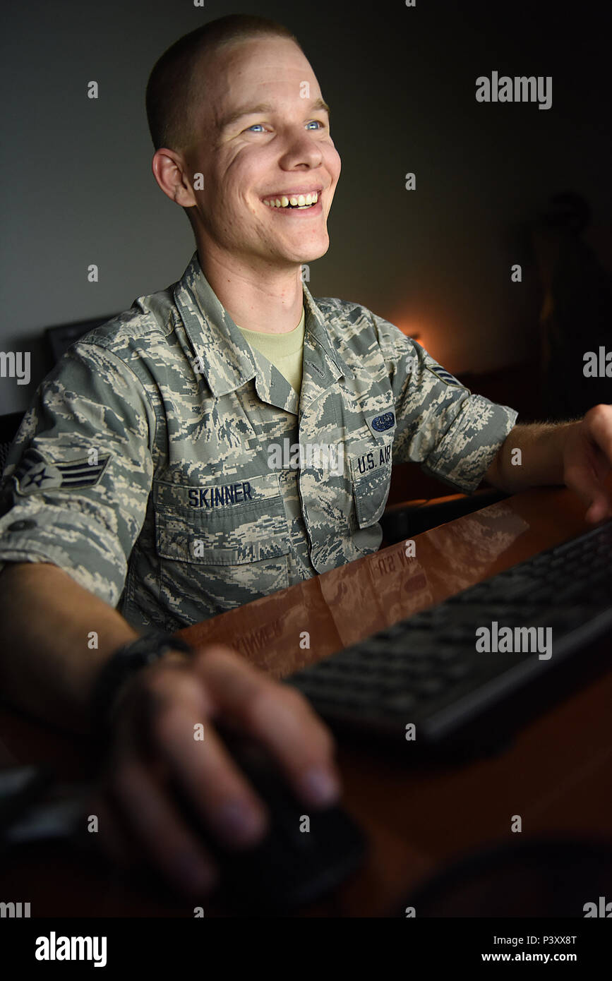 Senior Airman Jeffery Skinner, a cyber surety specialist from the 124th Communications Flight in Boise, Idaho, spends his days on the virtual frontlines protecting everything from radar systems, to databases, to computer networks from enemies trying to gather secret information or wreck havoc via cyber attack. (Air National Guard photo by Master Sgt. Becky Vanshur/Released) - Stock Image